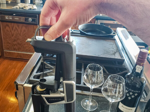 Insert Coravin needle into bottle of wine